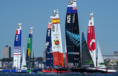 The New Zealand SailGP F50 catamaran with its Race for the Future partner, Live Ocean, on the wing sail.
