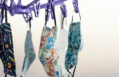 homemade masks hanging on the clothesline to dry.