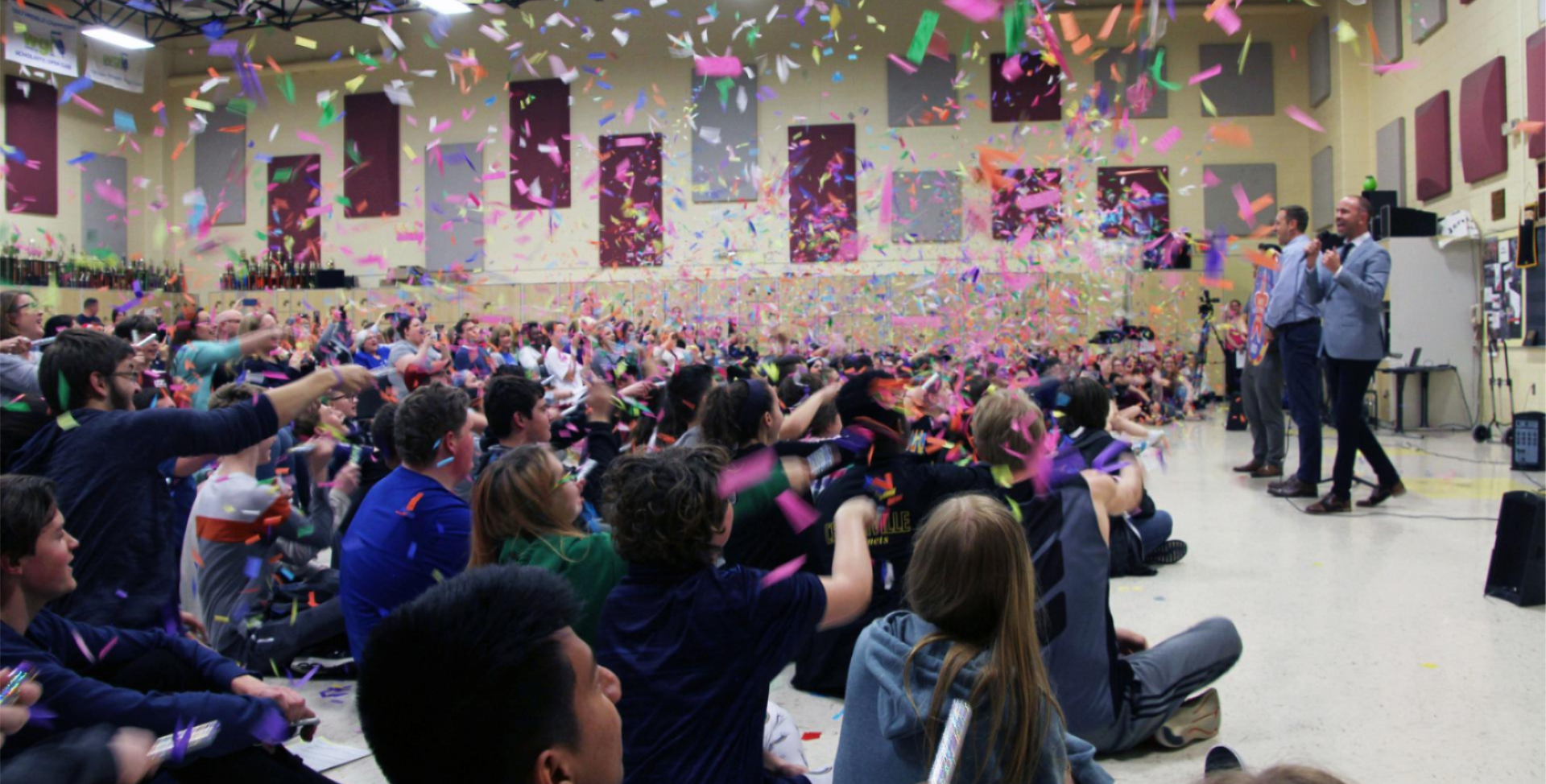 Image of band students throwing confetti
