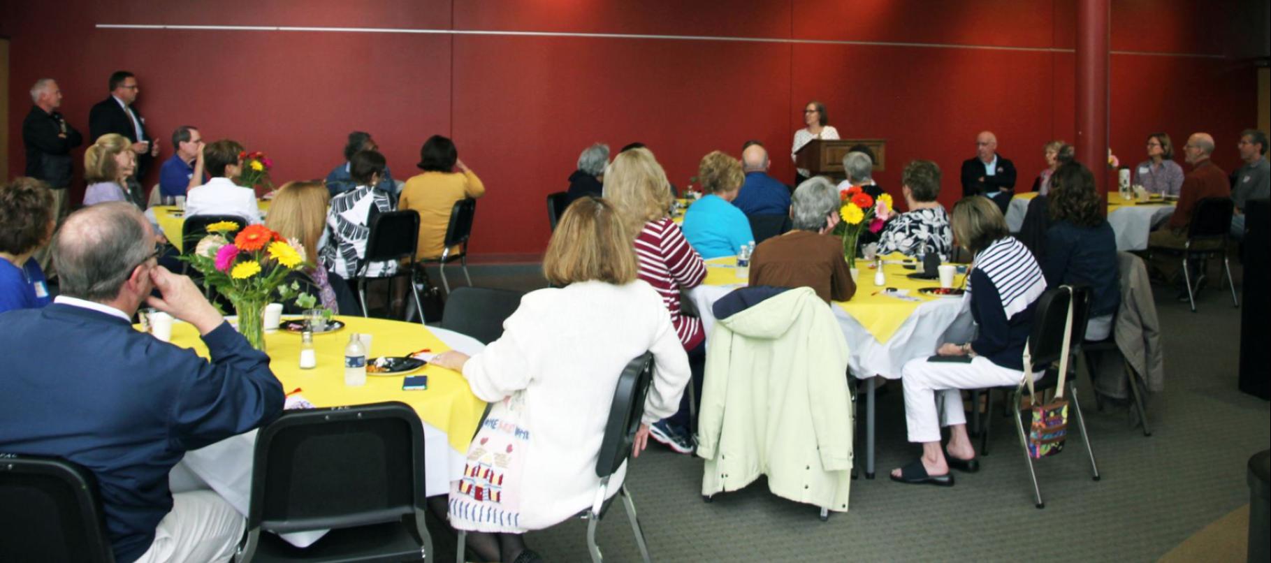 Image of volunteers at breakfast