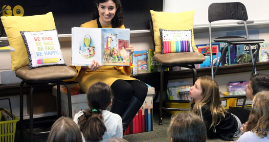 Image of Erica Schroder reading to students