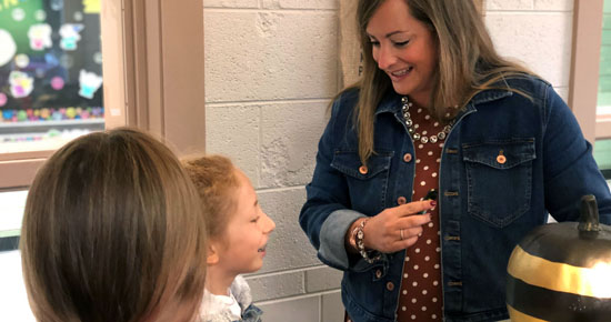 Image of Cline Principal Katy Barker with two students