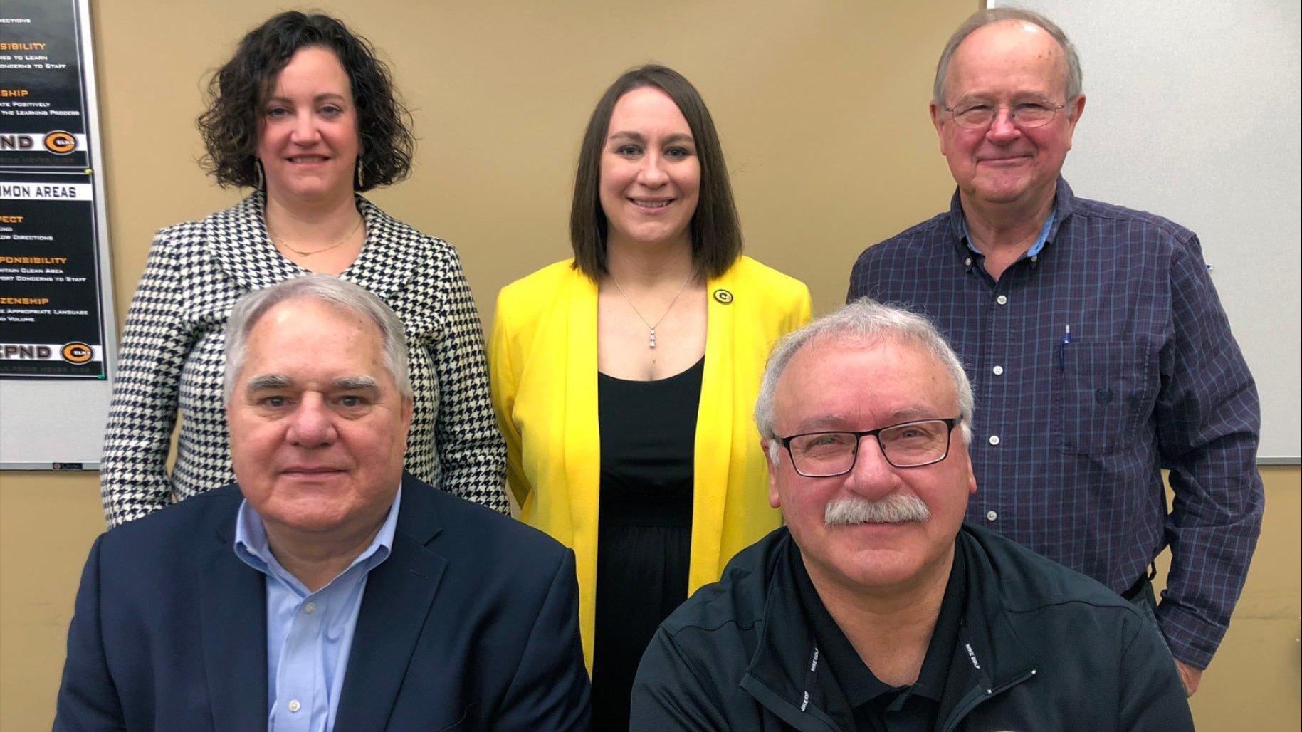 Image of five school board members