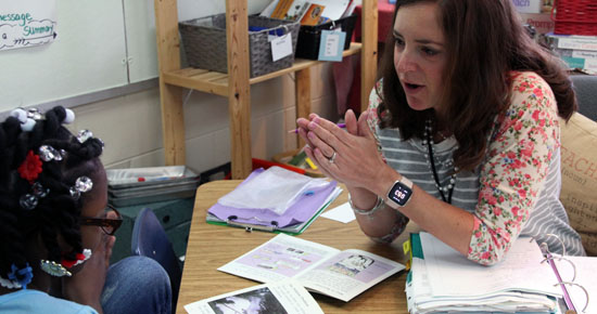Image of Mary Huelsman working with a student