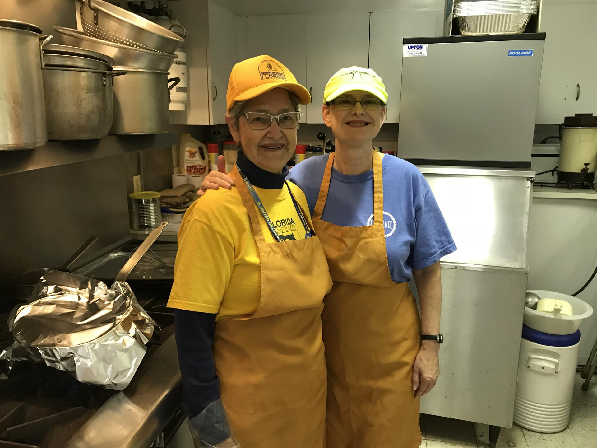 Marsha Robbins serving in a hurricane disaster relief kitchen with her mother