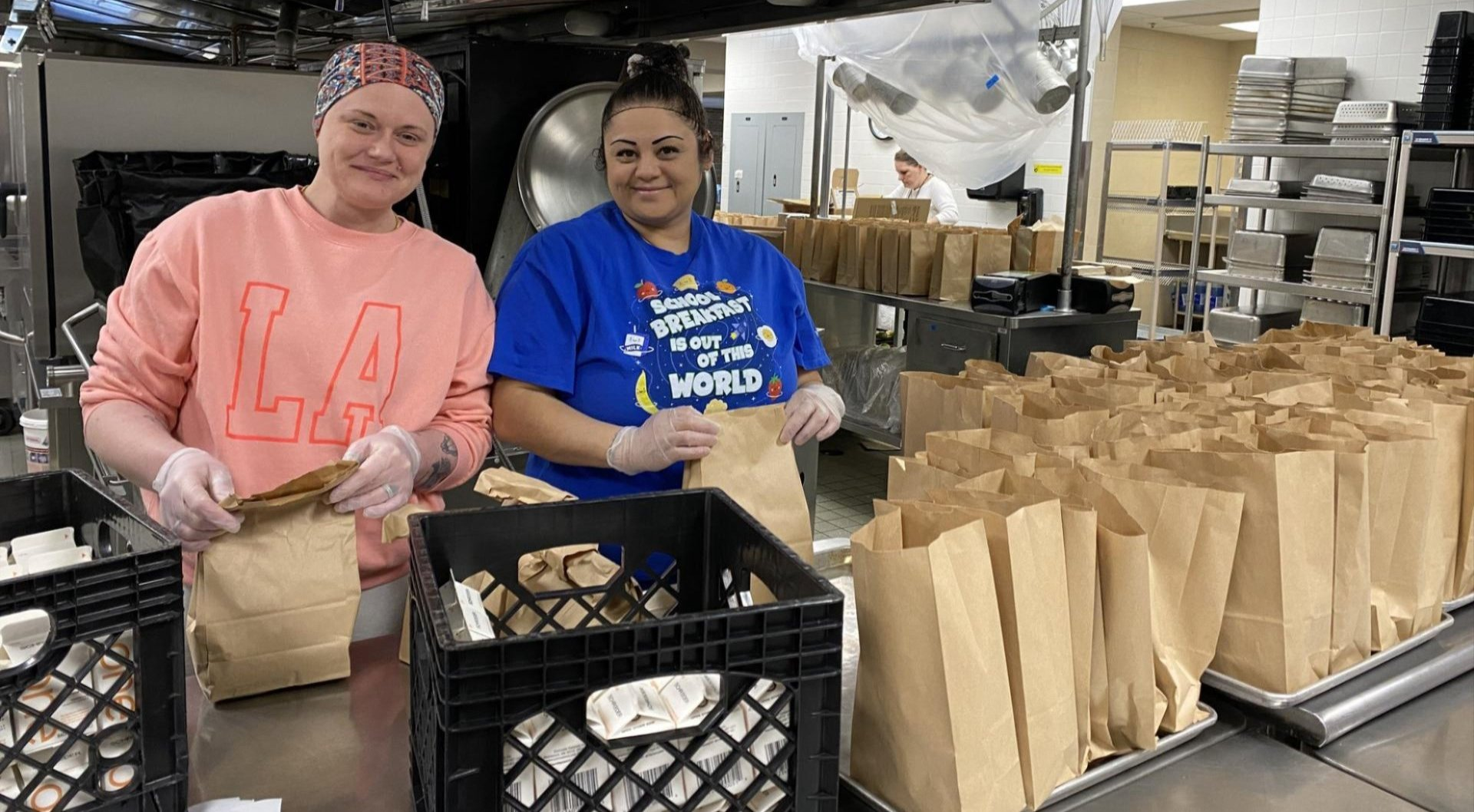 Nutritional Services staff bagging lunches