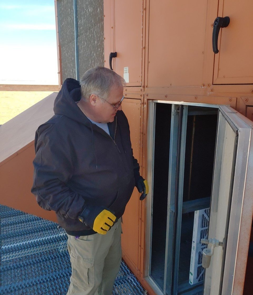 Buildings and Grounds staff - changing air filters