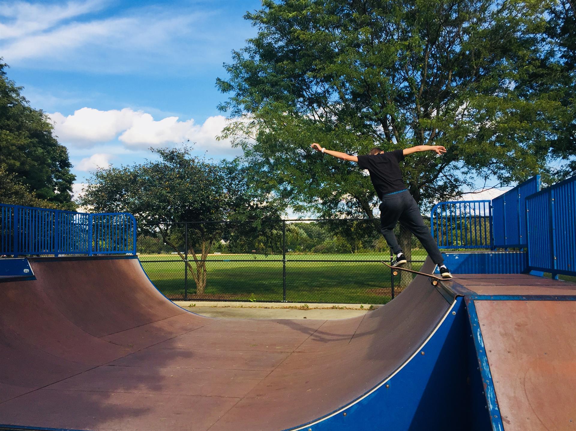 Skateboarder doing trick at a skate park