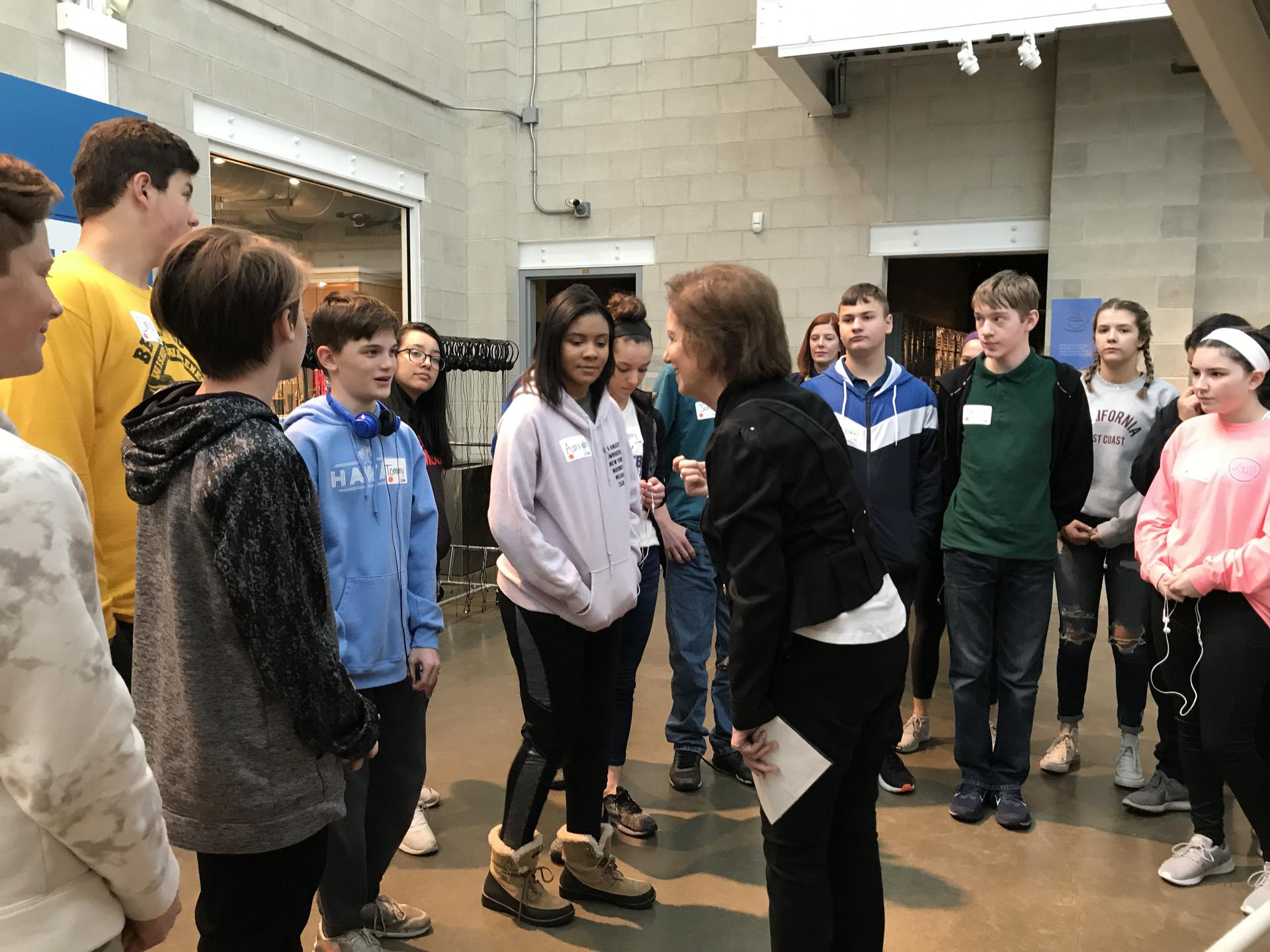Eighth graders listening to guide at Holocaust Museum