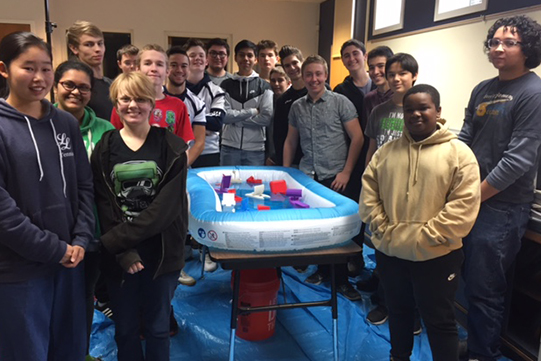 High School students around pool with 3D printed boats
