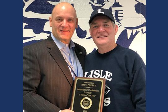 Principal Howard and Coach Parpet hold award