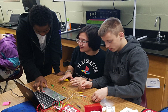 Eighth graders working on engineering project