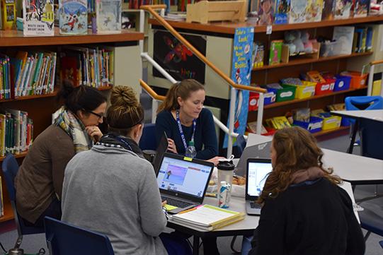 Teachers working on computers