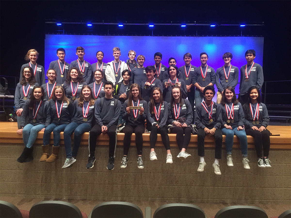 LHS Math Team wearing Conference Championship Medals
