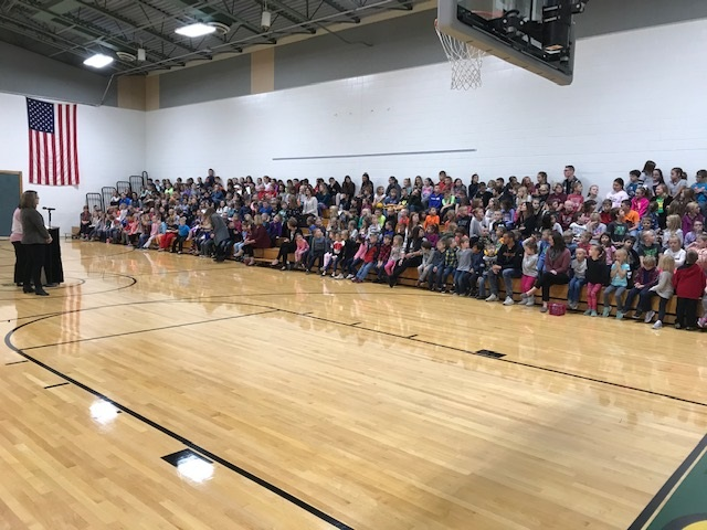 Picture of the Cole Student Body at the Awards Assembly in the gym.