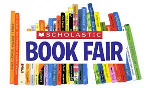 "Image of books stacked as on a shelf with the words ""Scholastic Book Fair"" written across the front"