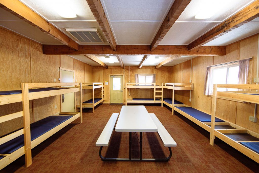 Image of Camp Tecumseh cabins with 15 bunks for students to sleep.