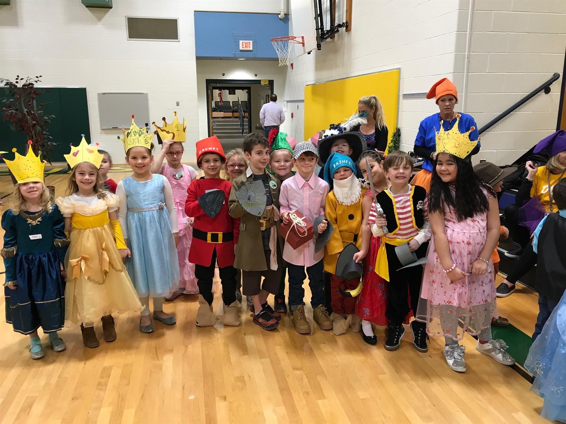 Kindergarten and first grade students dressed as princesses and princes and seven dwarfs from the K/1 Fairy Tale Ball.