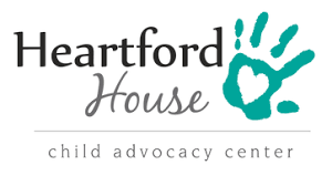 """Heartford House Logo - Heartford written in bold black with House in cursive ounderneath. To the right a green left hand print with a heart in the palm. Underneath is a line underneath is are the words """"Child Advocacy Center"""""""