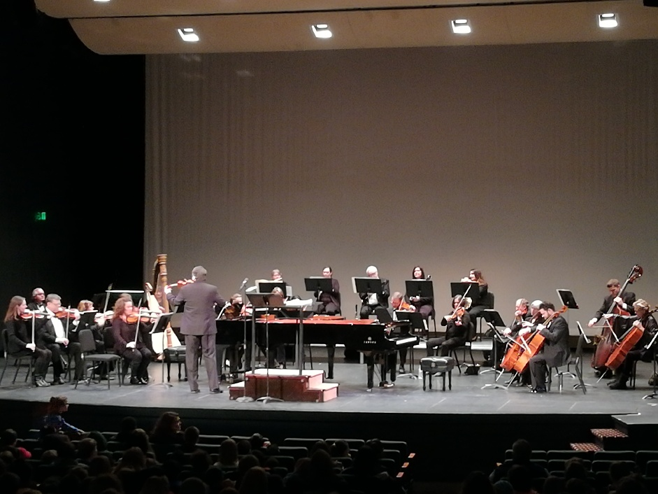 Image of the Lafayette Symphony Orchestra playing during the Lollipop Concert in Lafayette to Cole Fourth Graders.