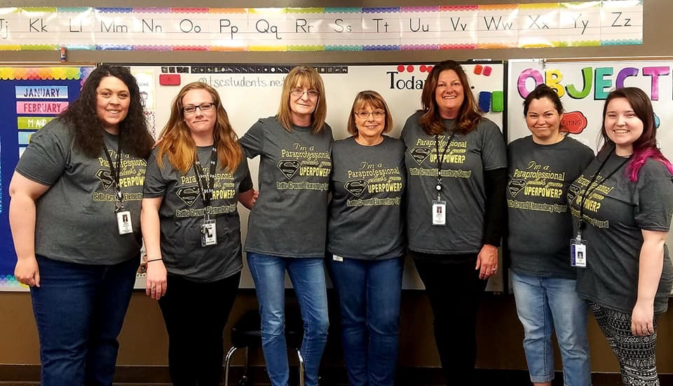 A picture of our BGE paras with their matching T-Shirts  that say ''I'm a paraprofessional  - what's your SUPERPOWER?