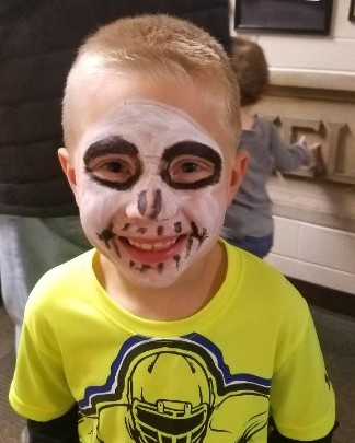 boy with his face painted