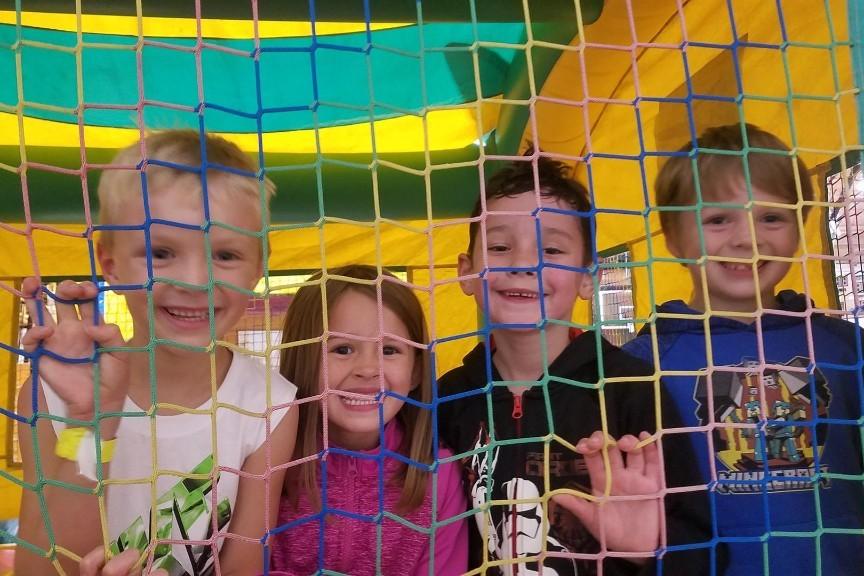 4 kids in a bouncy house