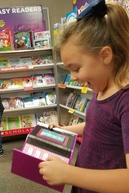 girl excited about a book