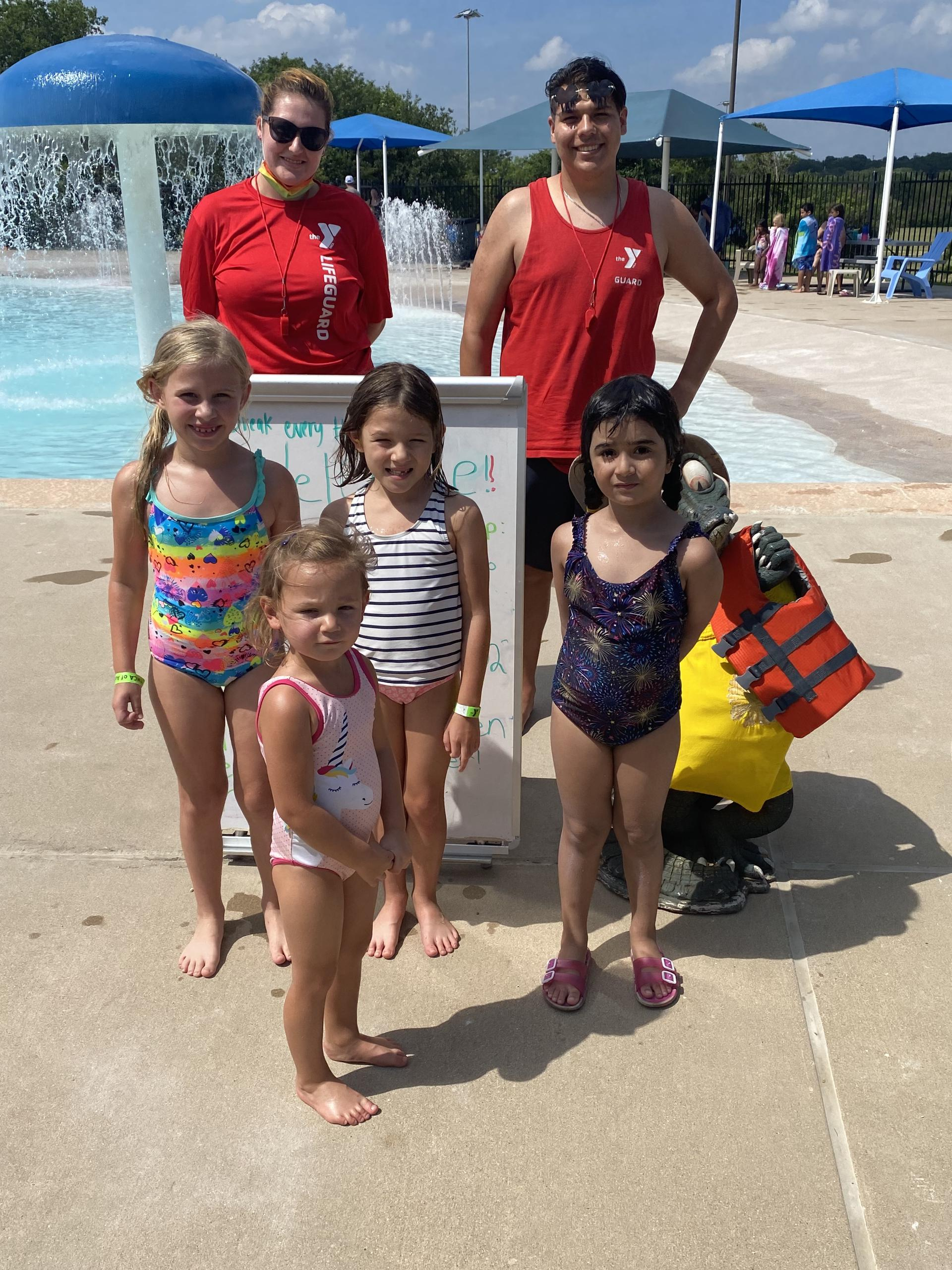 kids with lifeguards at pool