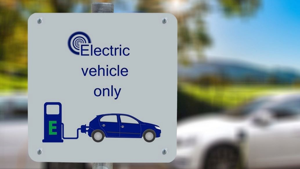 electric vehicle only sign