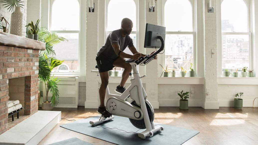 man on a myx exercise bike