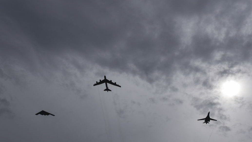 A B-2, B-52, and B-1 bombers fly over Guam in 2016
