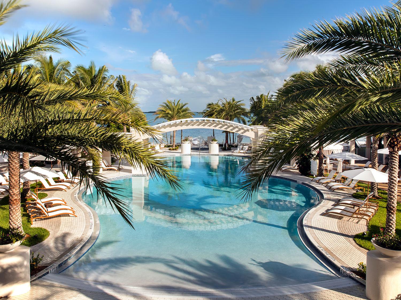 A beach side pool and lounge area.