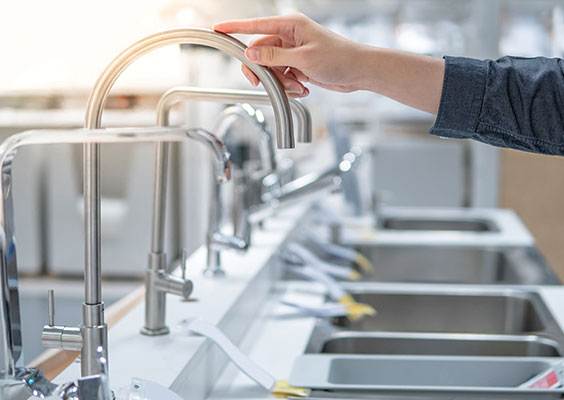 viewing sinks in kitchen showroom