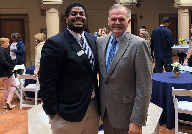 President Harris and Shane Davis '19