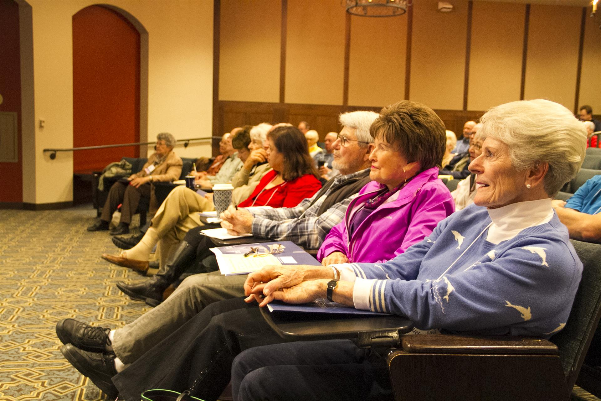 Life-long learners listen intently as President Harris speaks during January's University of the Third Age session.