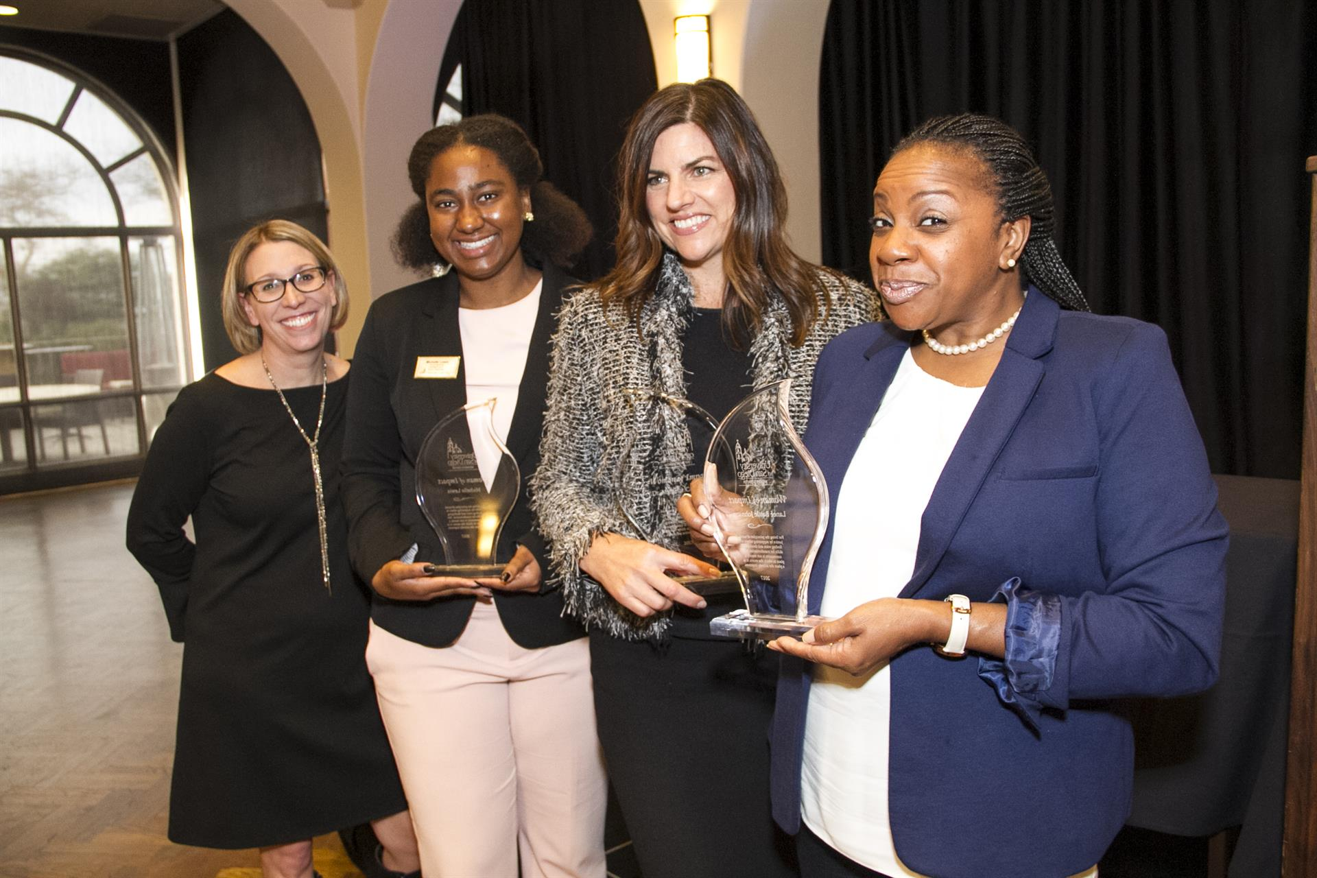 Women's Center Director Erin Lovette-Colyer with three 2017 Women of Impact Award winners.