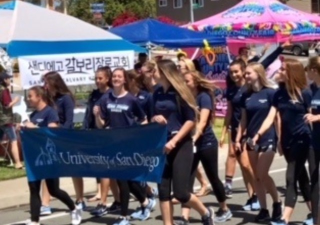 USD students marching at the MultiCultural Fair and Parade